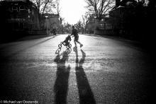 Street Photography Amsterdam stroller skater